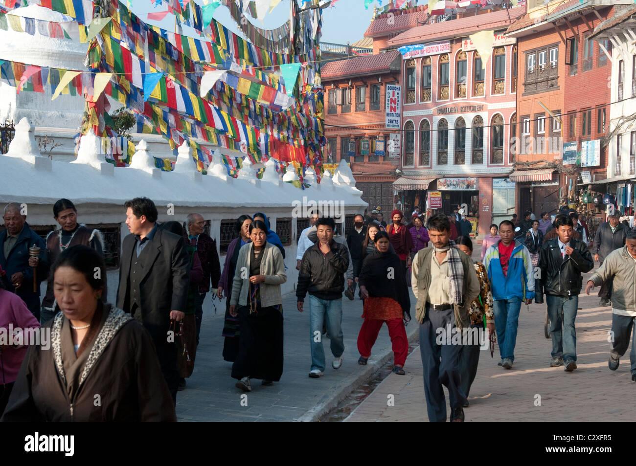Worshippers circumambulate the Boudha Stupa near Kathmandu, Nepal - Stock Image