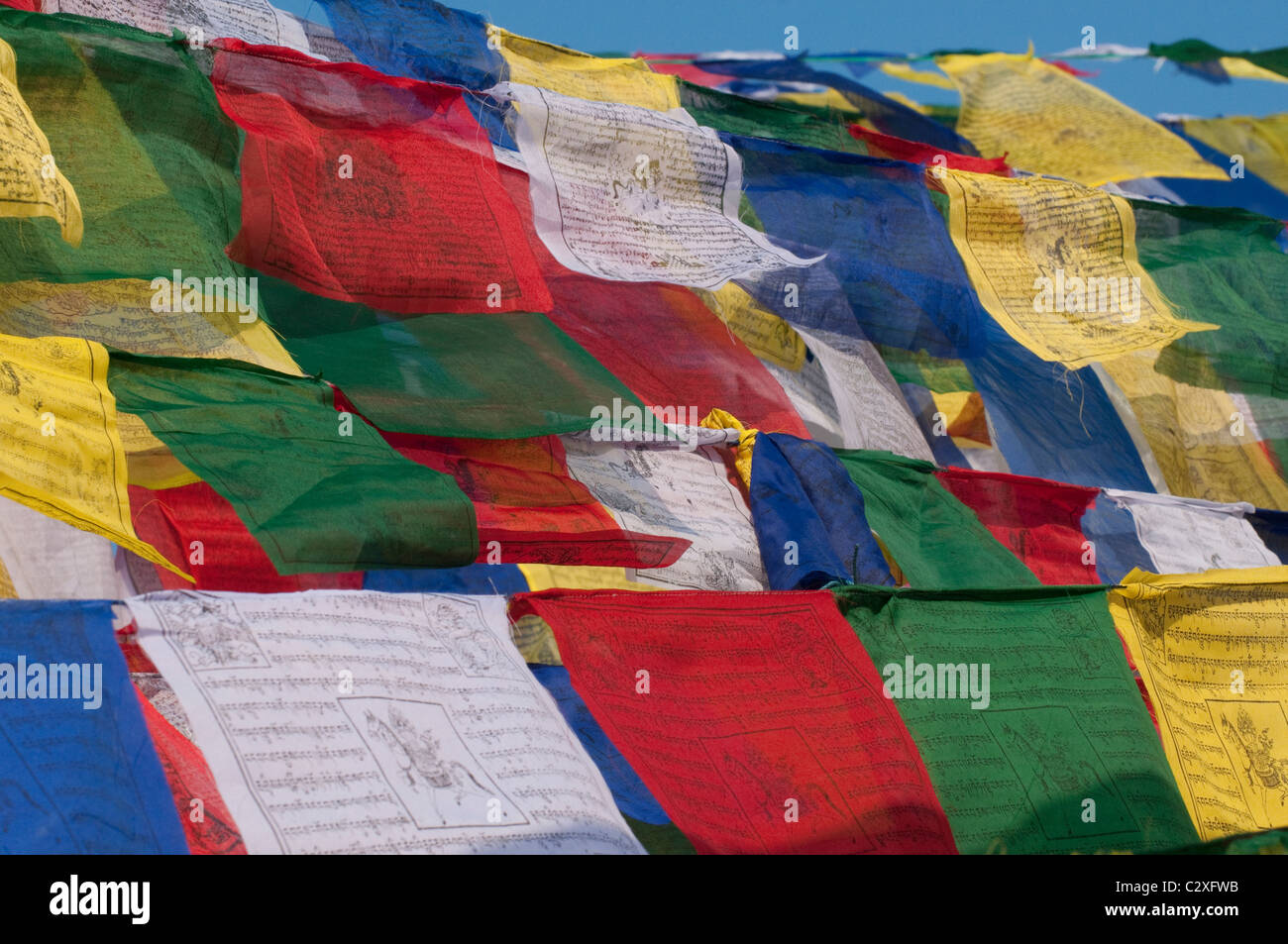 Prayer flags adorn the Boudha Stupa near Kathmandu, Nepal - Stock Image