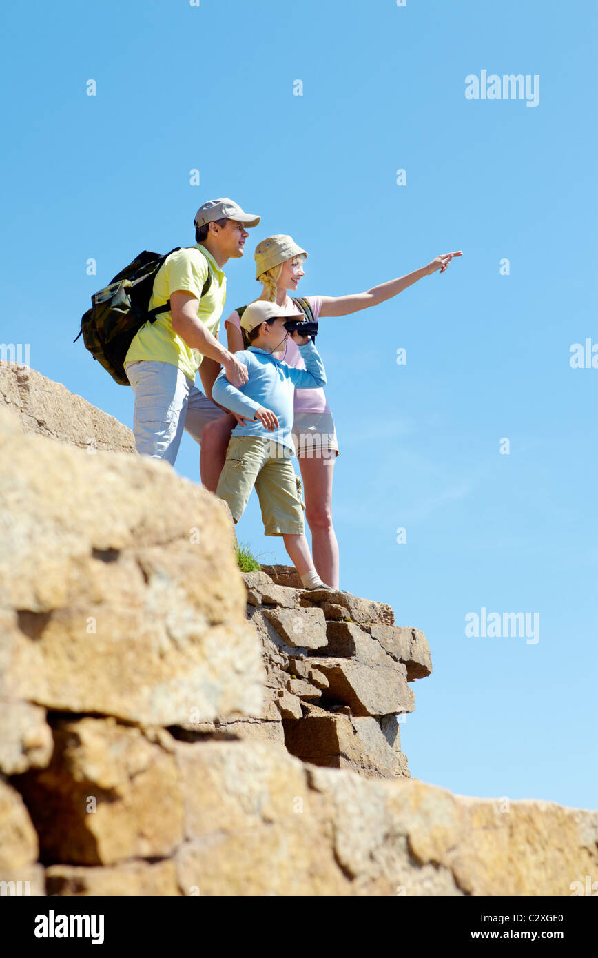 Portrait of family members looking afar outside while standing on cliff Stock Photo