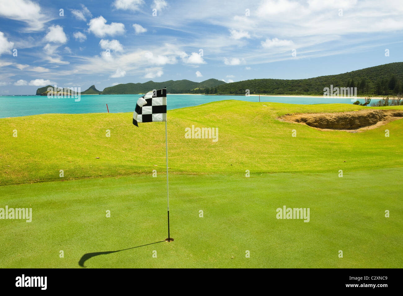 'Honour payment' golf course and lagoon on the ancient volcanic World Heritage site Lord Howe Island, New - Stock Image
