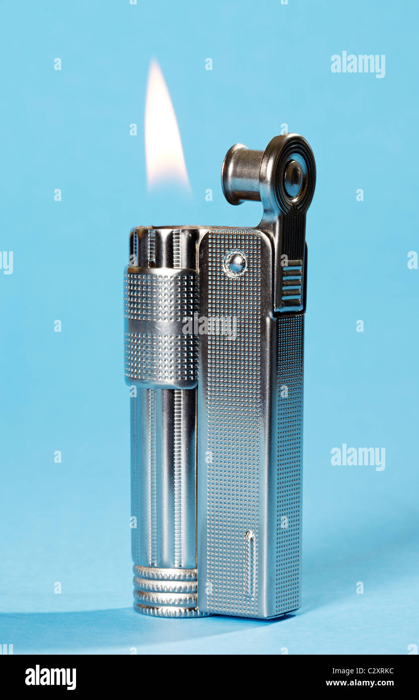 Petrol Lighter on blue background - Stock Image