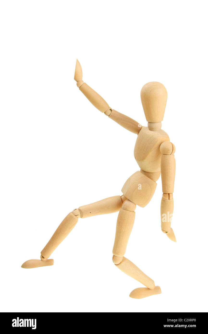 Artist's wooden mannequin in a martial arts pose - Stock Image