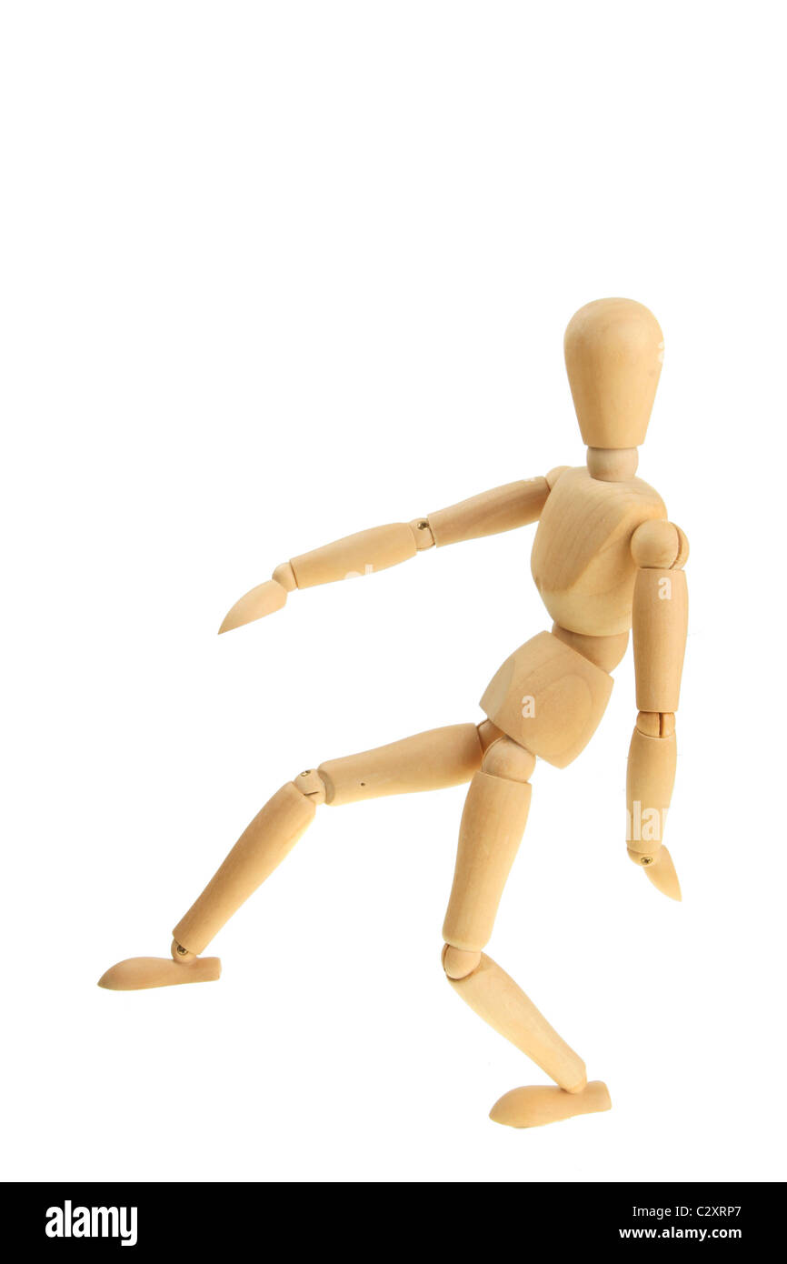 Artist's wooden mannequin in a pacing pose - Stock Image