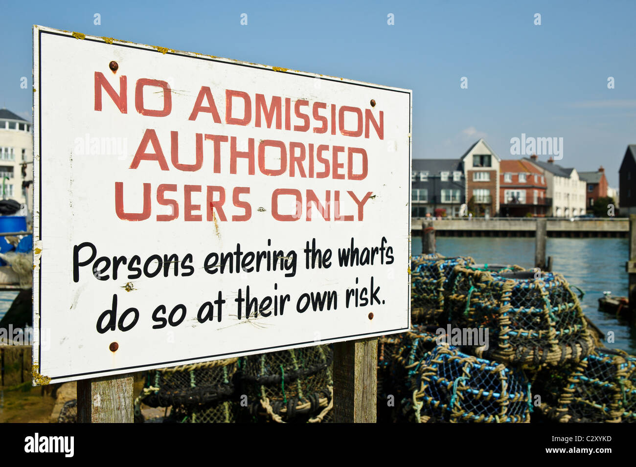 A 'No Admission' sign advising access to a wharf on the River Arun. Littlehampton, West Sussex. - Stock Image