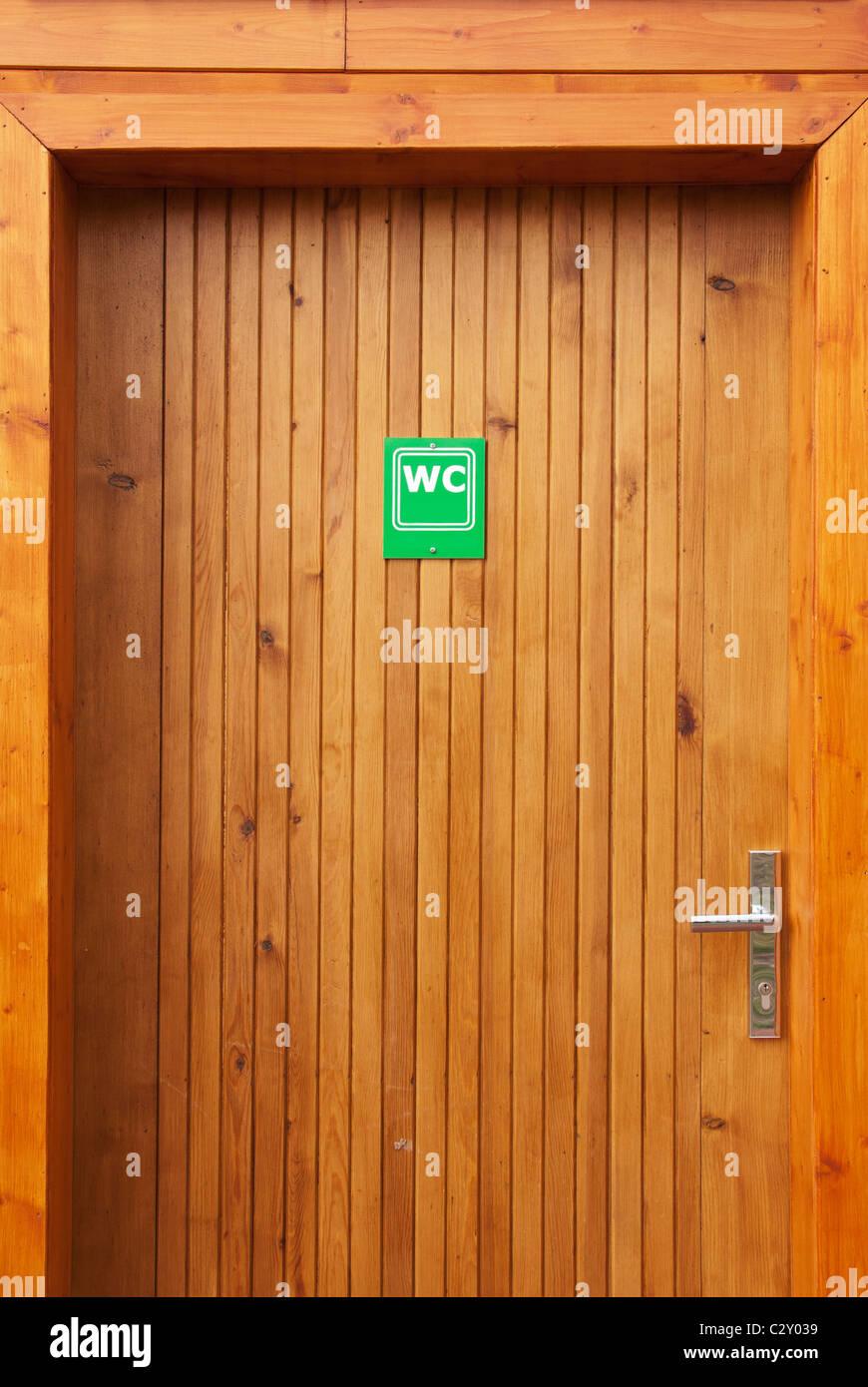 wooden door with WC sign - Stock Image