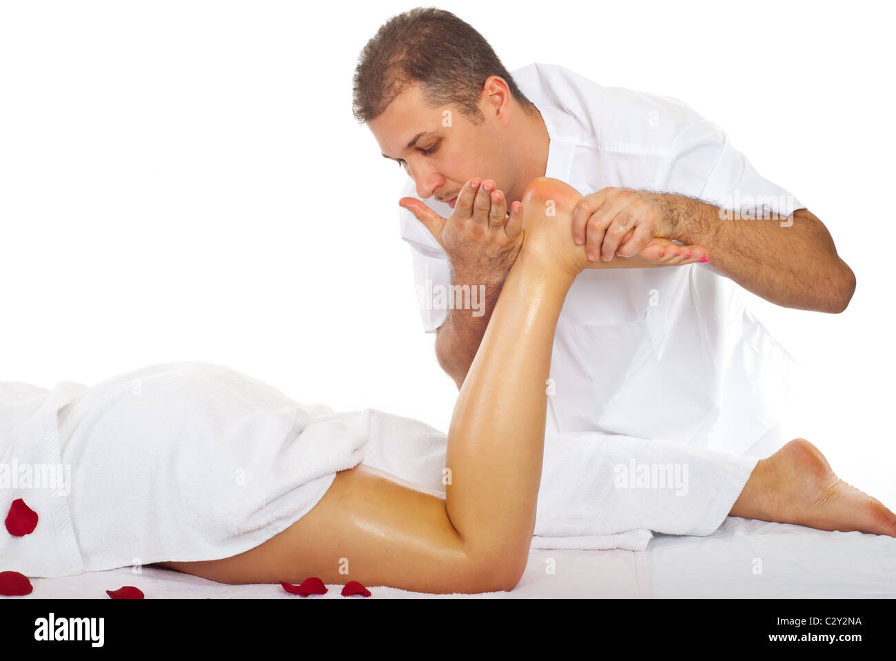 Masseur giving anti cellulite massage to a woman legs in a