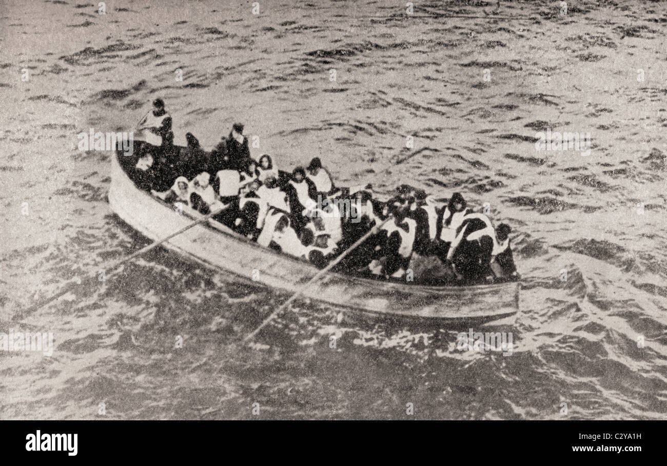 Survivors of the RMS Titanic in one of her collapsible lifeboats, just before being picked up by the Carpathia. - Stock Image
