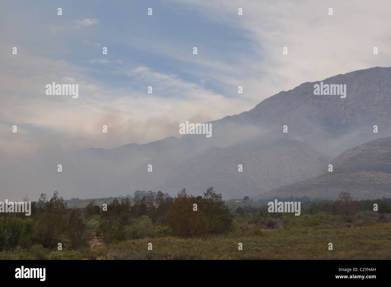 Bush Fire that is out of control, flames, smoke, landscape - Stock Image