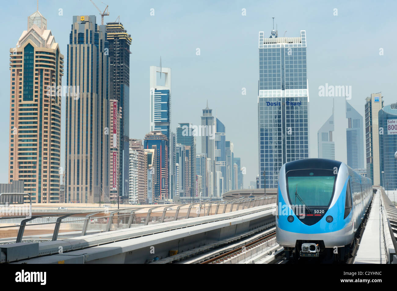 View of Dubai metro train and office towers in financial district of Dubai United Arab Emirates UAE - Stock Image