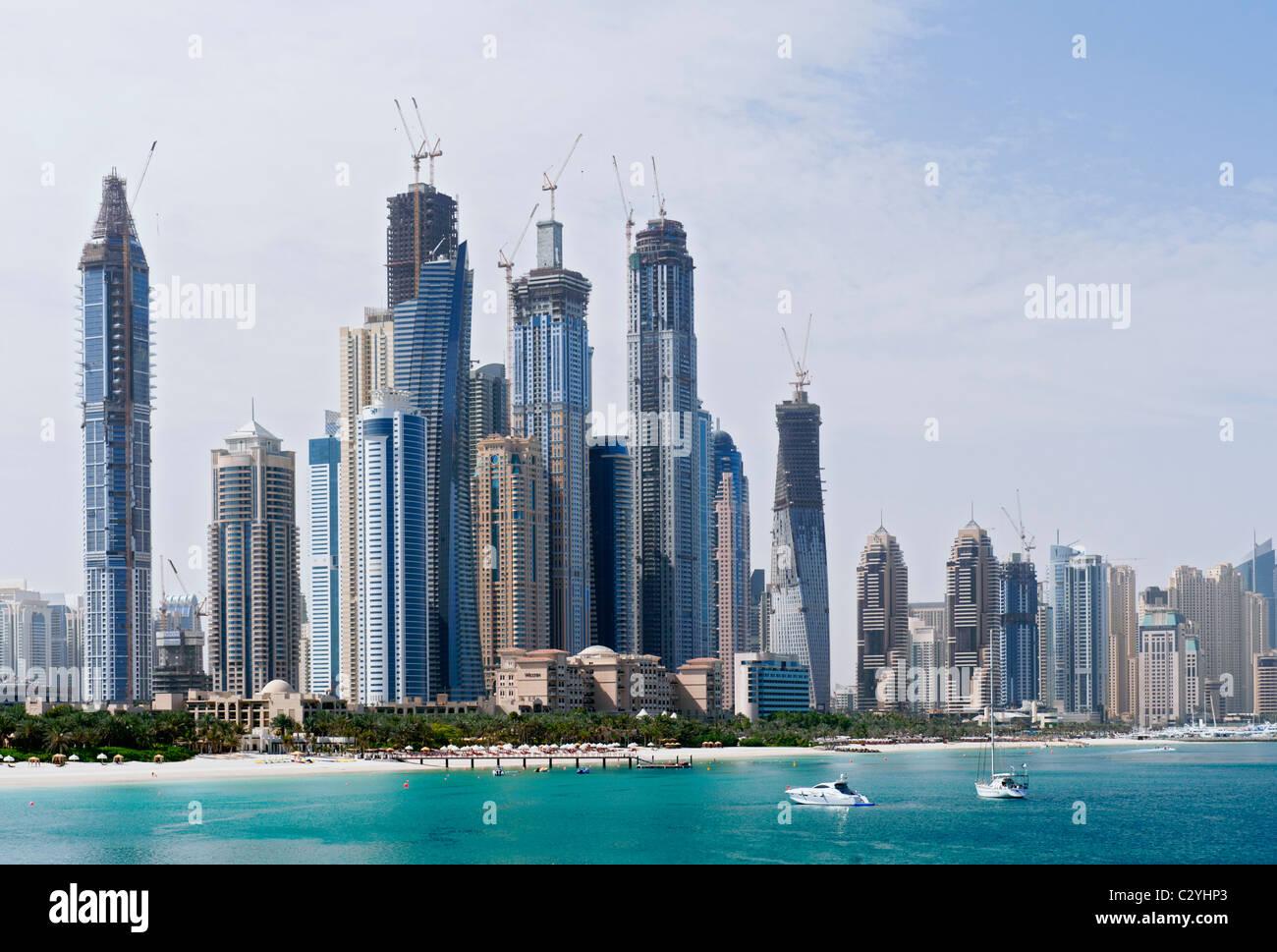 Skyline of modern high rise towers at Dubai Marina district United Arab Emirates UAE - Stock Image