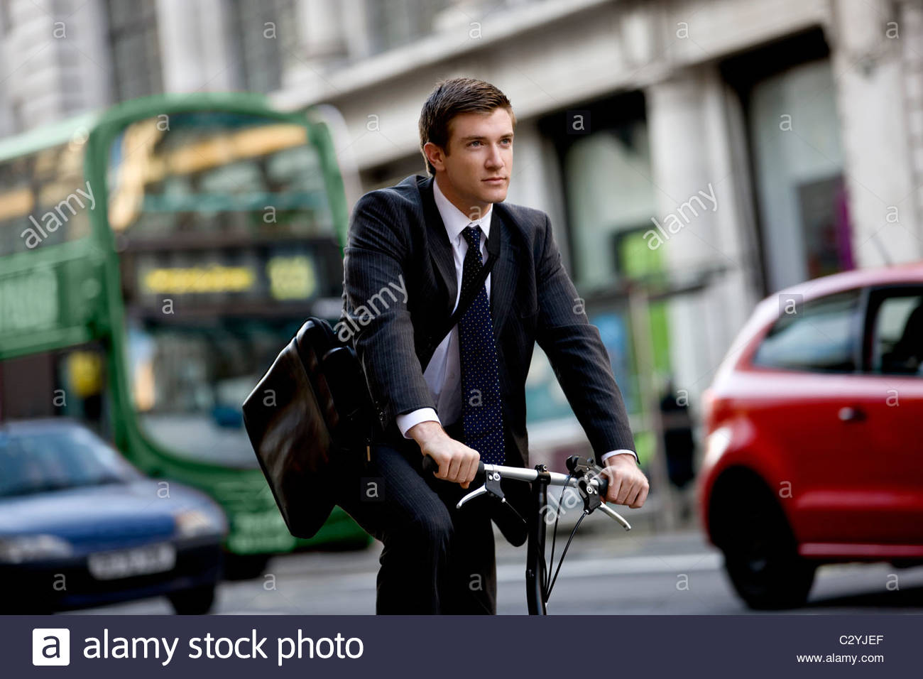A businessman commuting to work - Stock Image