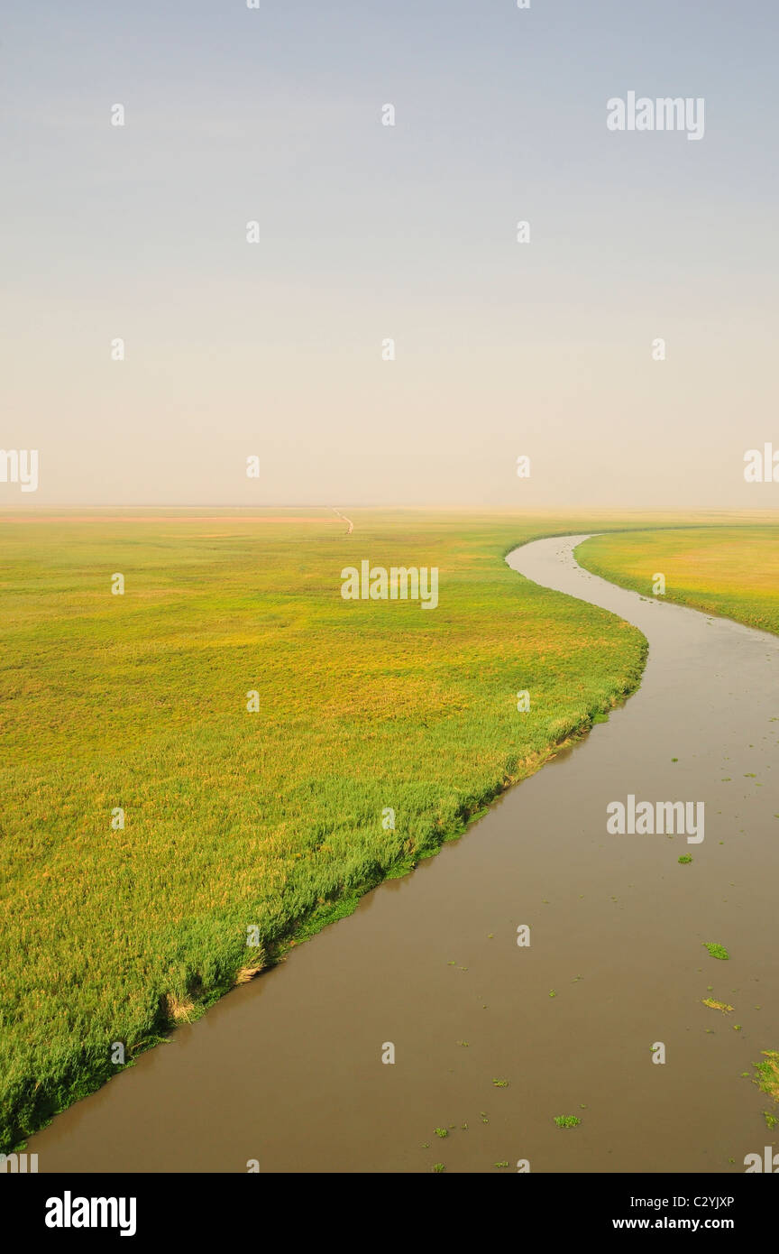 Bahr el Jabal near to Lake Nou with exploration road heading into swamp, Northern Sudd, South Sudan - Stock Image