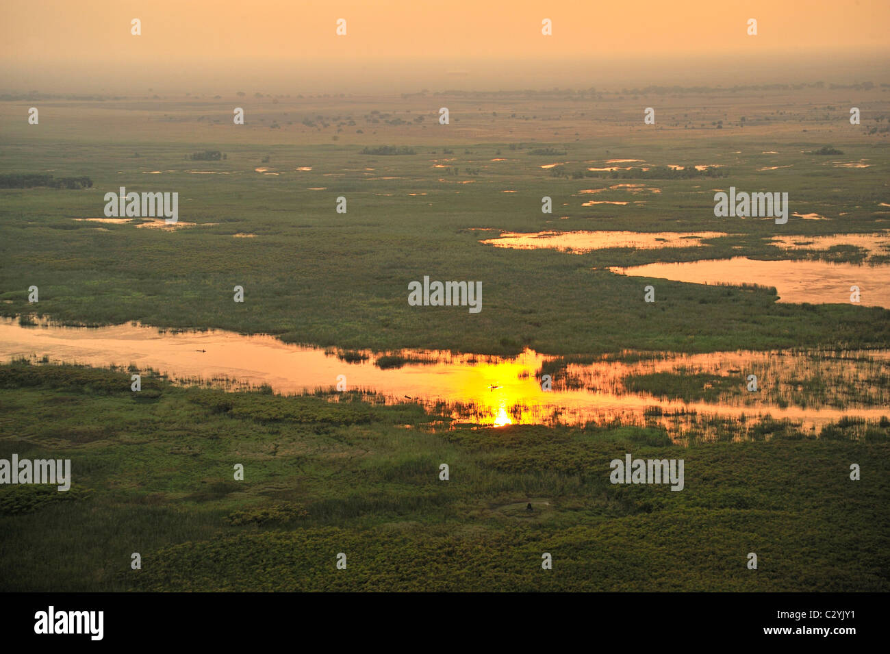 Fisherman in channel at sunset, Sudd Swamp, South Sudan - Stock Image