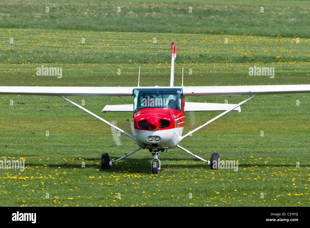 Cessna 152, reg G-GFIG, taxiing at Barton Airfield, Manchester - Stock Image