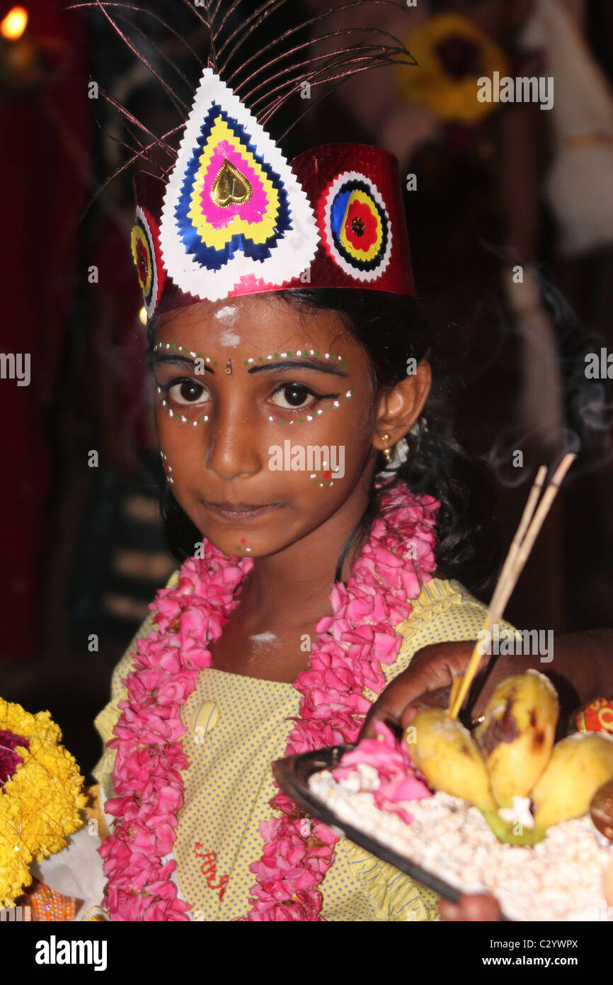 Indian girl with a headdress and makeup in a Vishnu festival near Kovalam Keral India - Stock Image