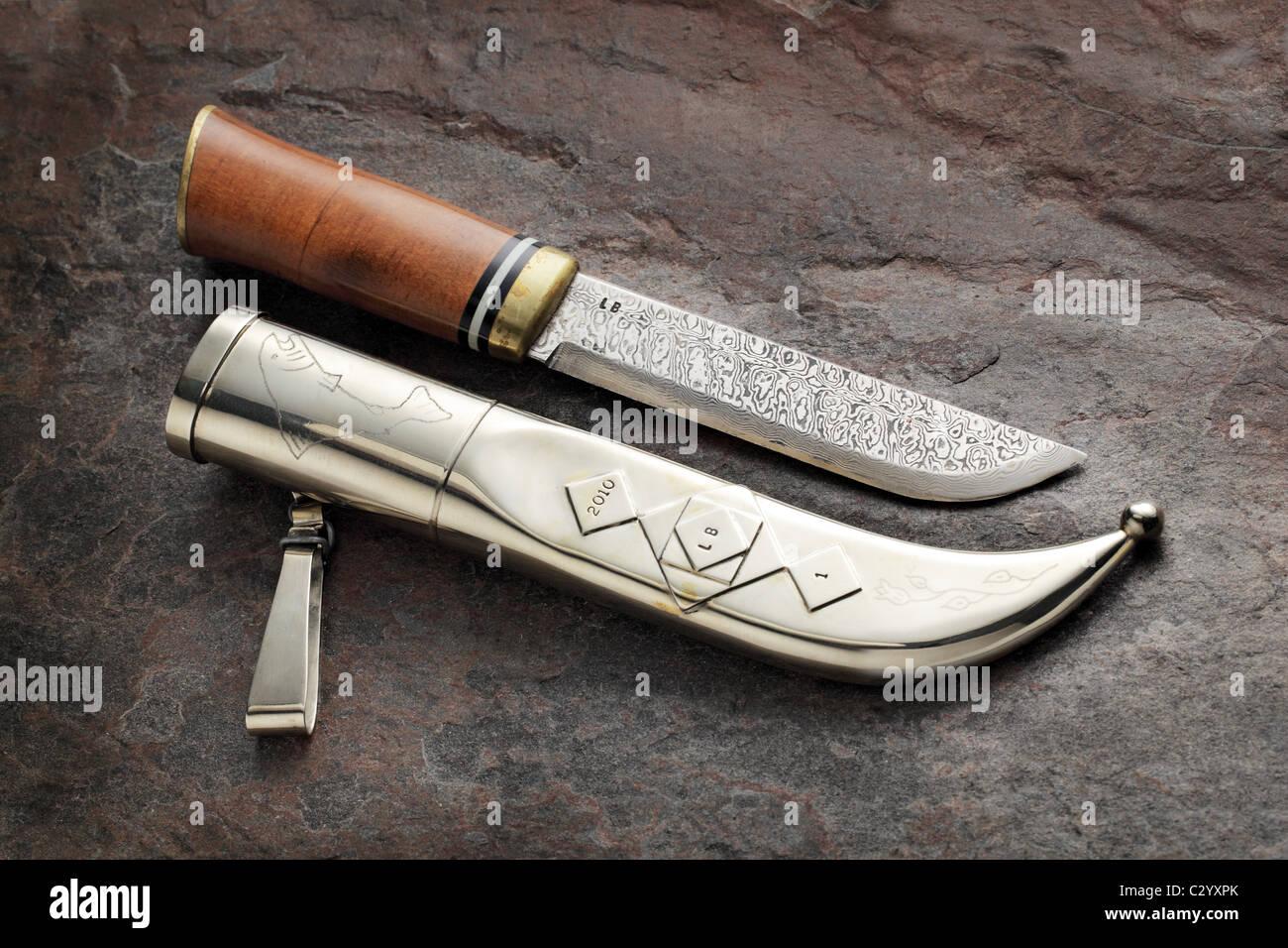 Handmade finnish 'puukko' knife. A puukko is a traditional Finnish or Scandinavian style belt-knife. - Stock Image