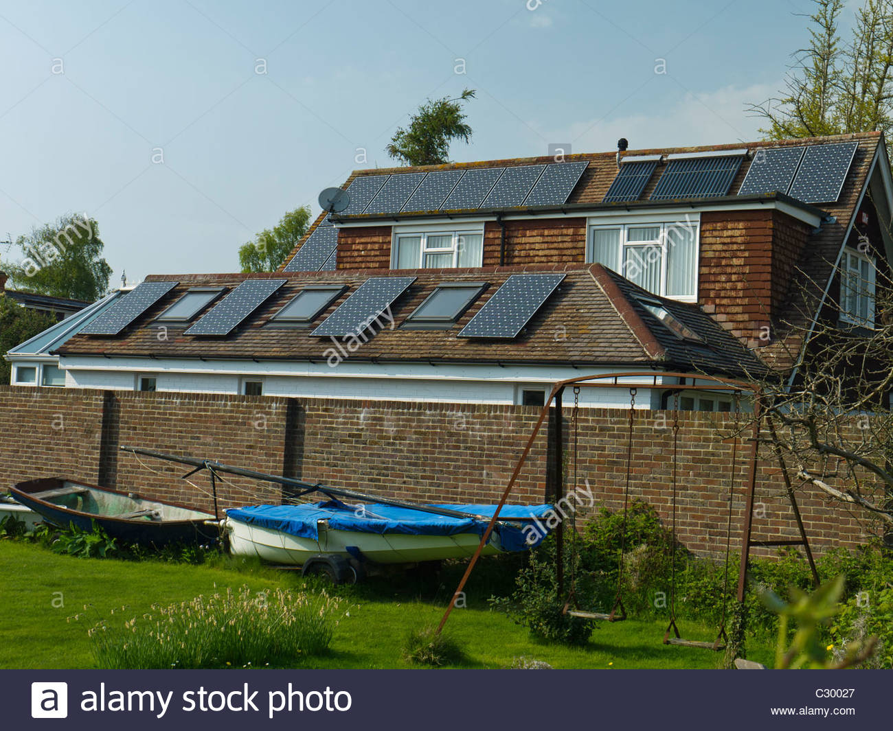 England ,UK Hampshire Solar Panels on House Roof Energy Power Electricity Hot Water - Stock Image