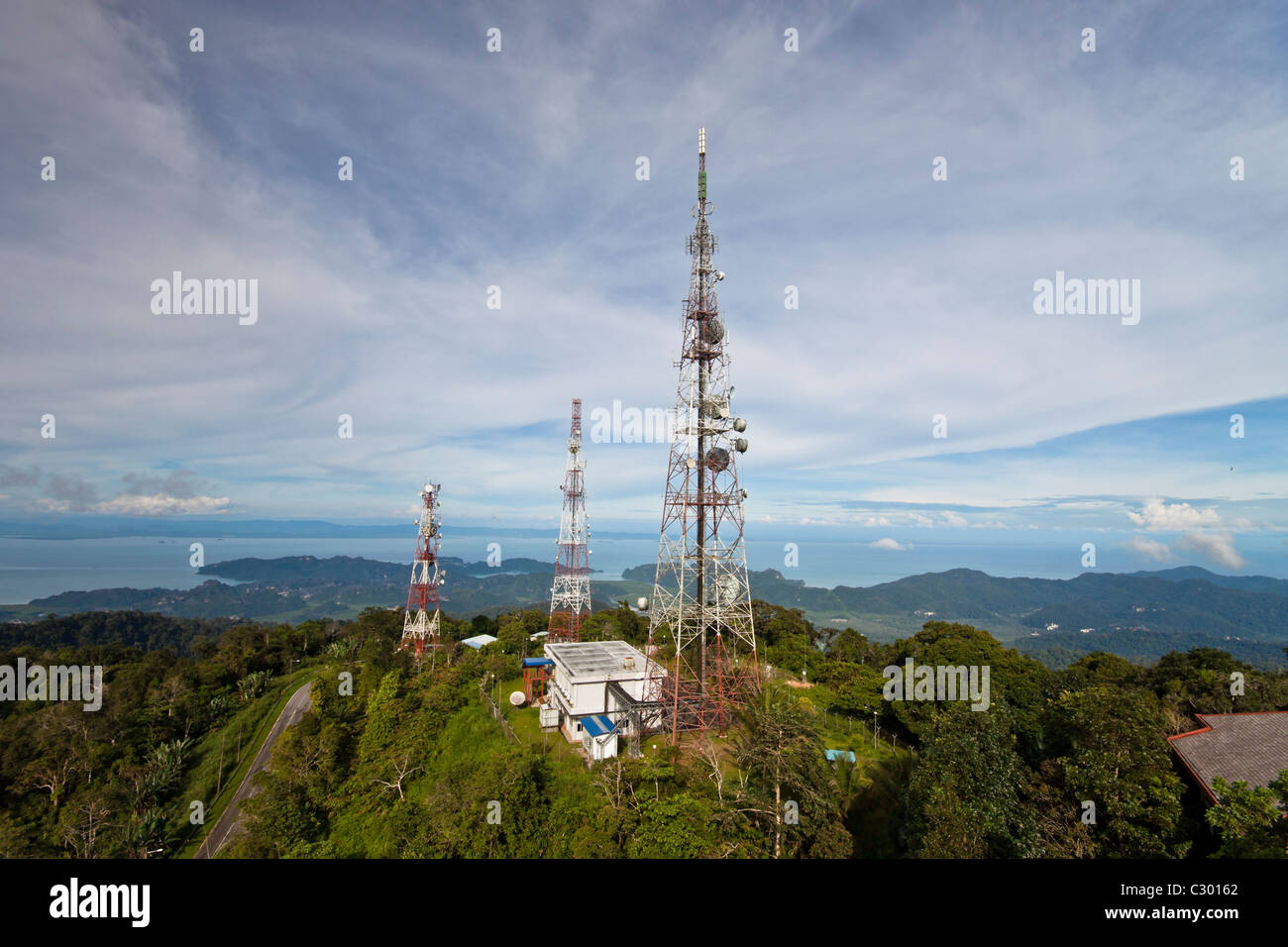 telecommunications towers on the top of the hill, Langkawi, Malaysia - Stock Image