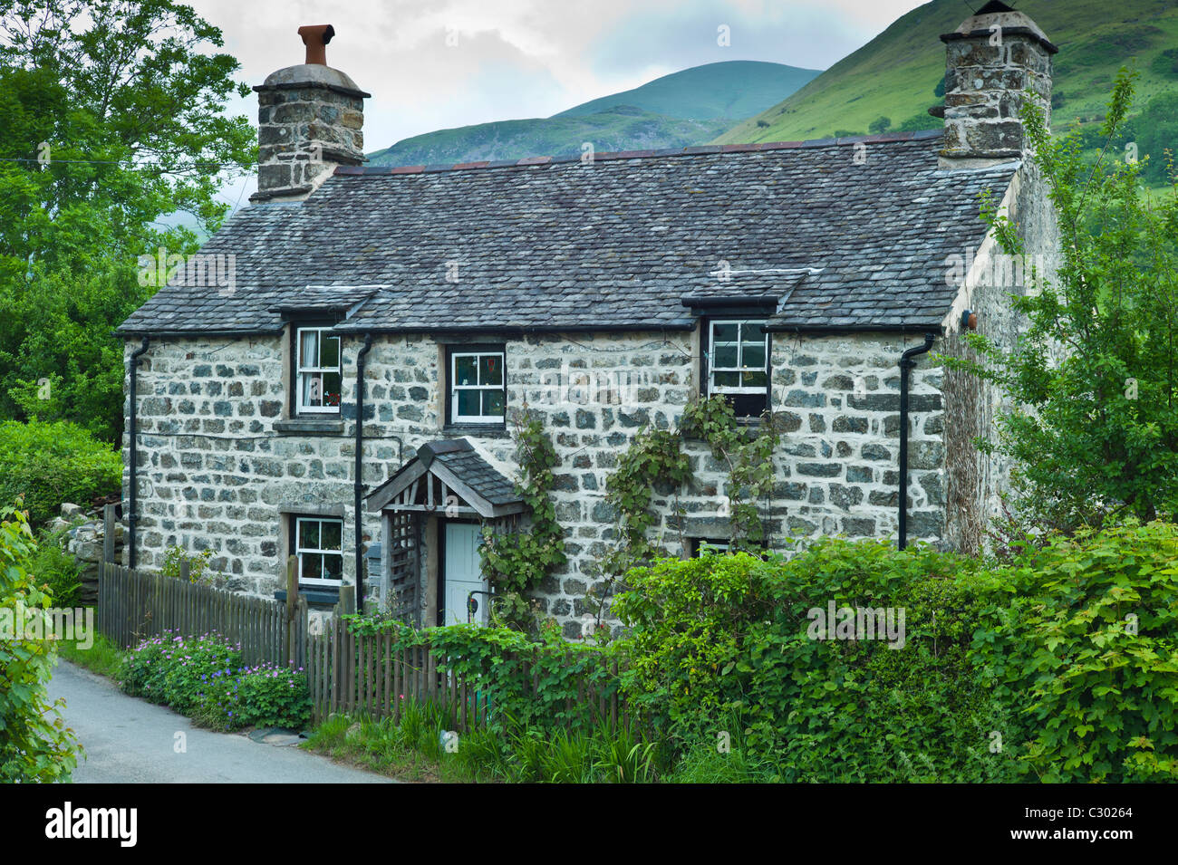 Traditional Stone Cottage With Welsh Slate Roof At Stock