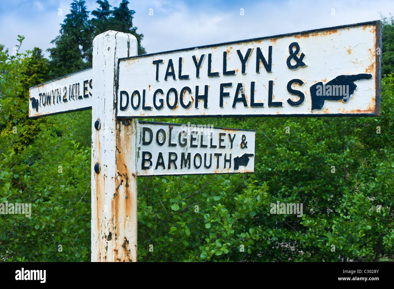 Signpost to Dolgelley, Barmouth, Talyllyn and Dolgoch Falls in Snowdonia, Gwynedd, Wales - Stock Image