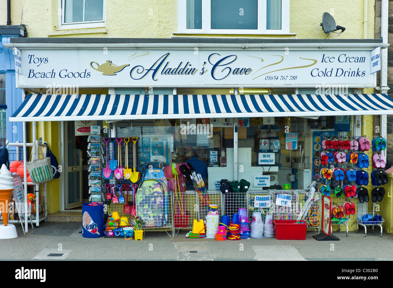 Aladdin's Cave general store selling seaside products and souvenirs in Aberdyfi, Aberdovey, Snowdonia, Wales - Stock Image