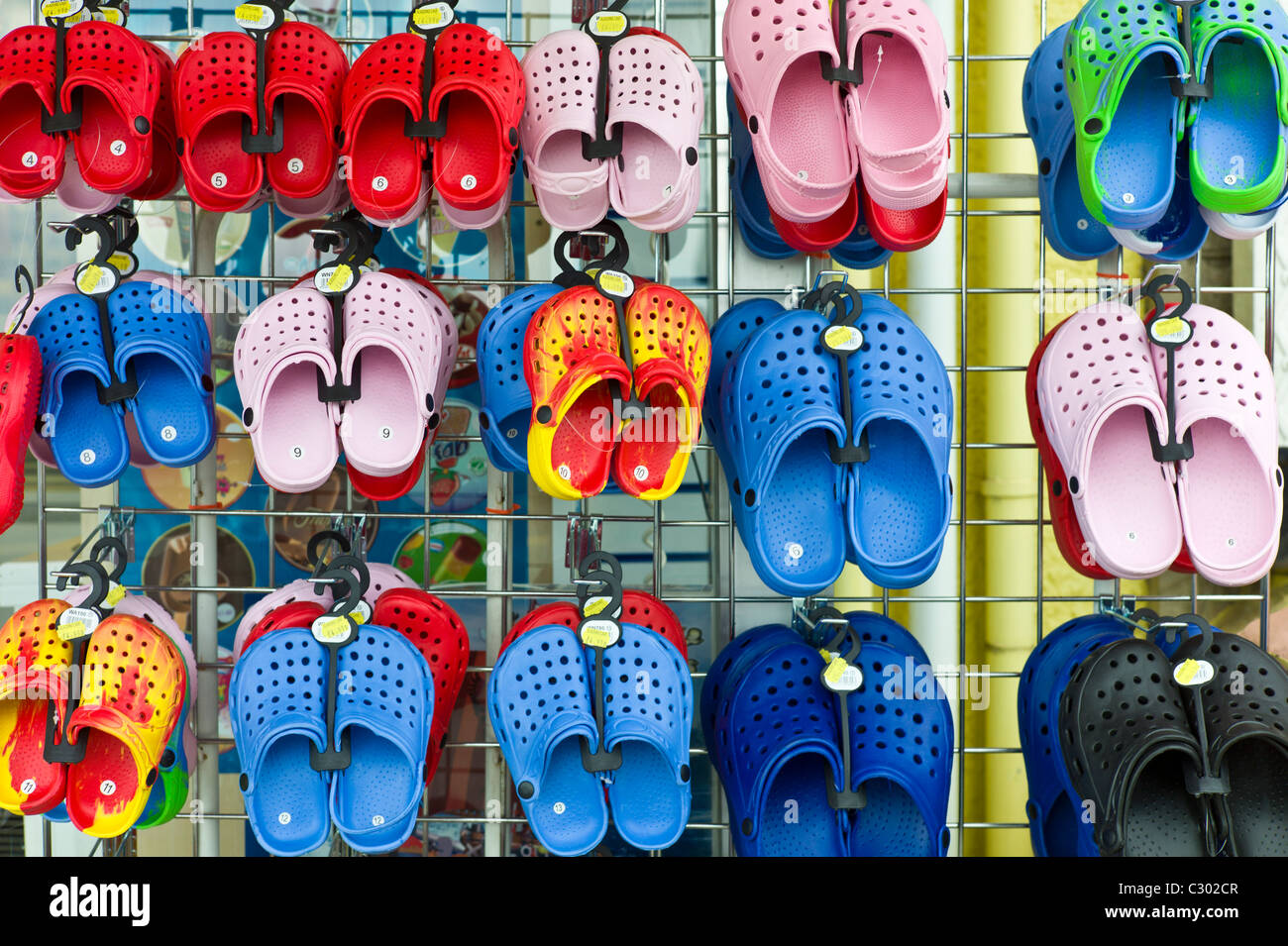 56ba11910 Beach shoes on sale at general store selling seaside products in Aberdyfi