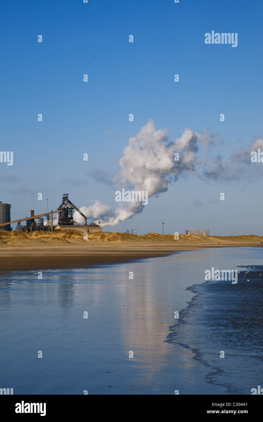 Redcar steelworks and steam from beach - Stock Image