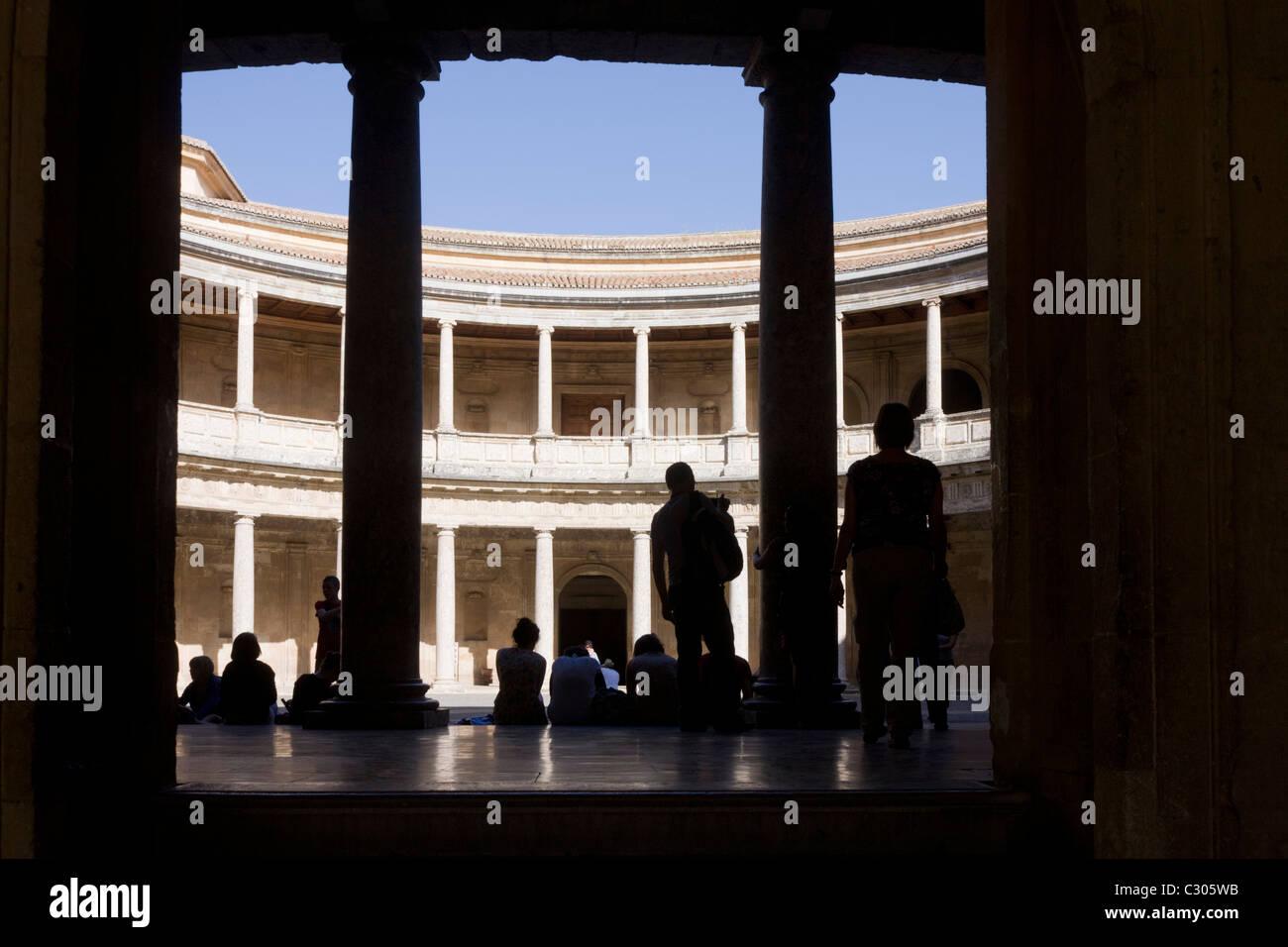 Visitors admire the inner circle of Palacio de Carlos V at Alhambra, Garana. - Stock Image