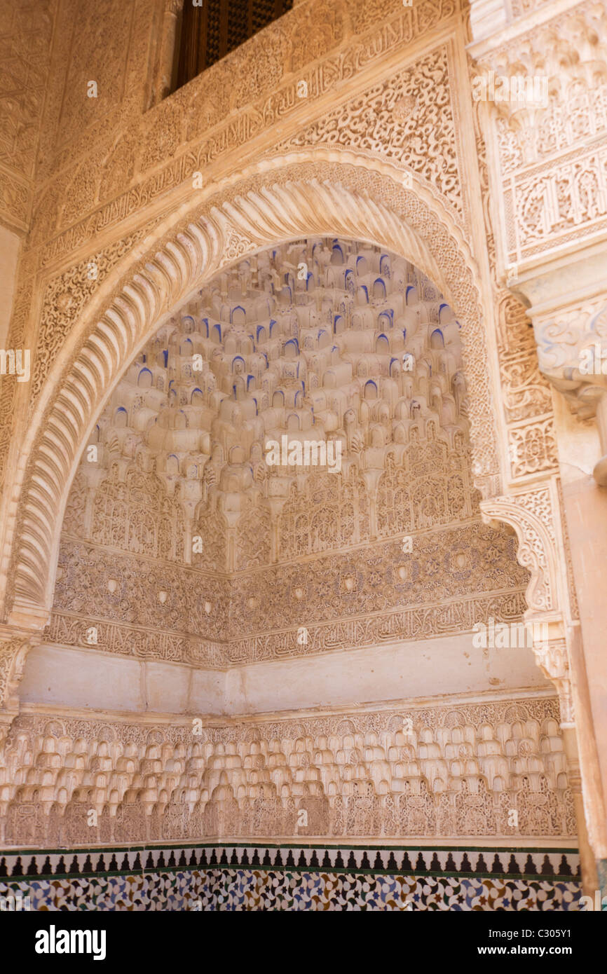 Ornate architectural artwork on courtyard walls of Nasrid Palace Stock Photo