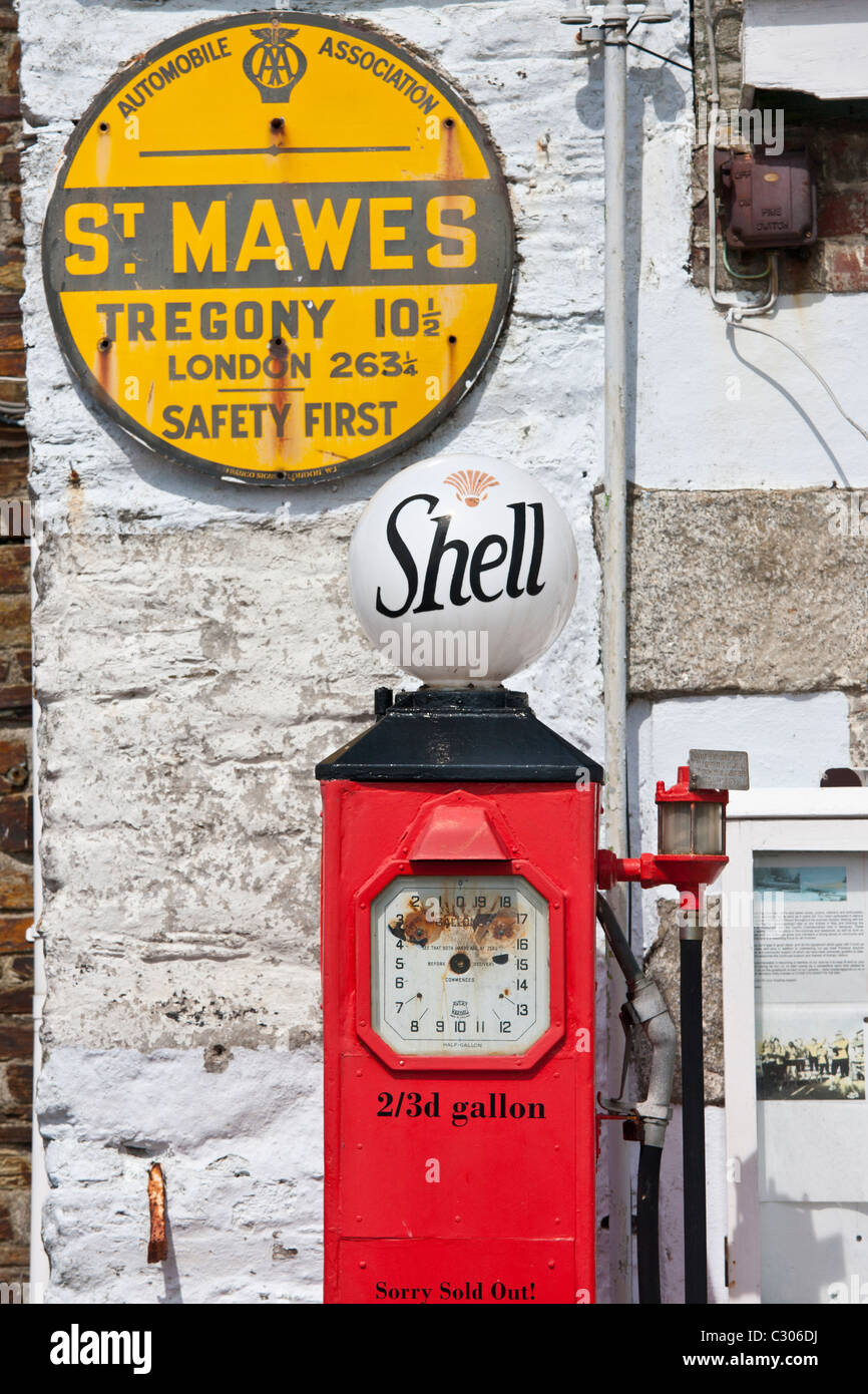 Vintage Shell petrol pump and Automobile Association AA sign ephemera at St Mawes tourist attraction, Cornwall, - Stock Image