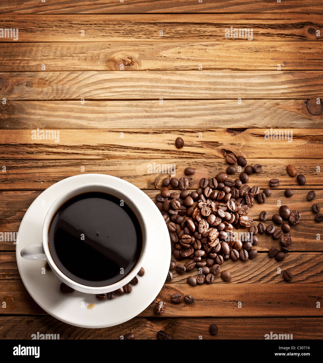 Cup of coffee. View from above on a wooden surface. Stock Photo