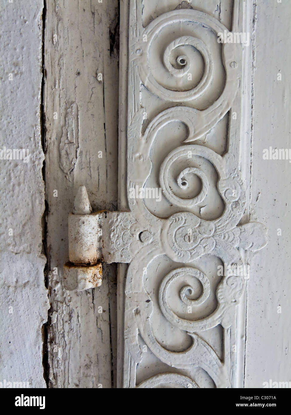 Hinge of an old door of a house - Stock Image