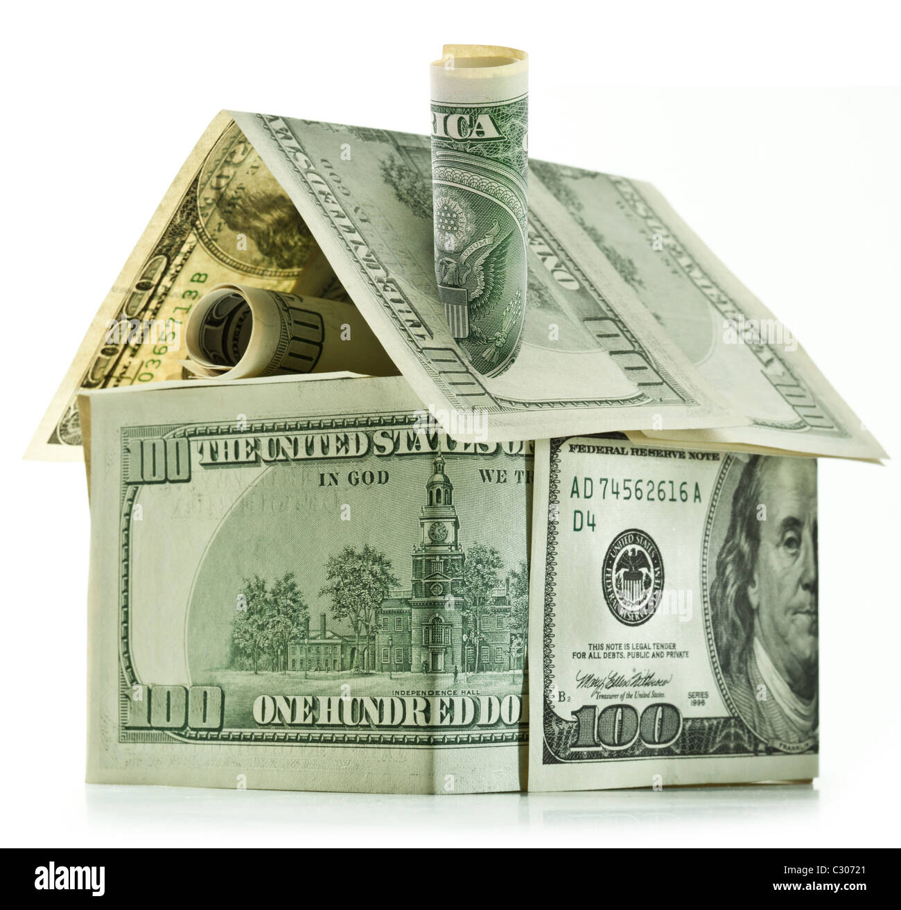 Dollar house isolated over white. - Stock Image