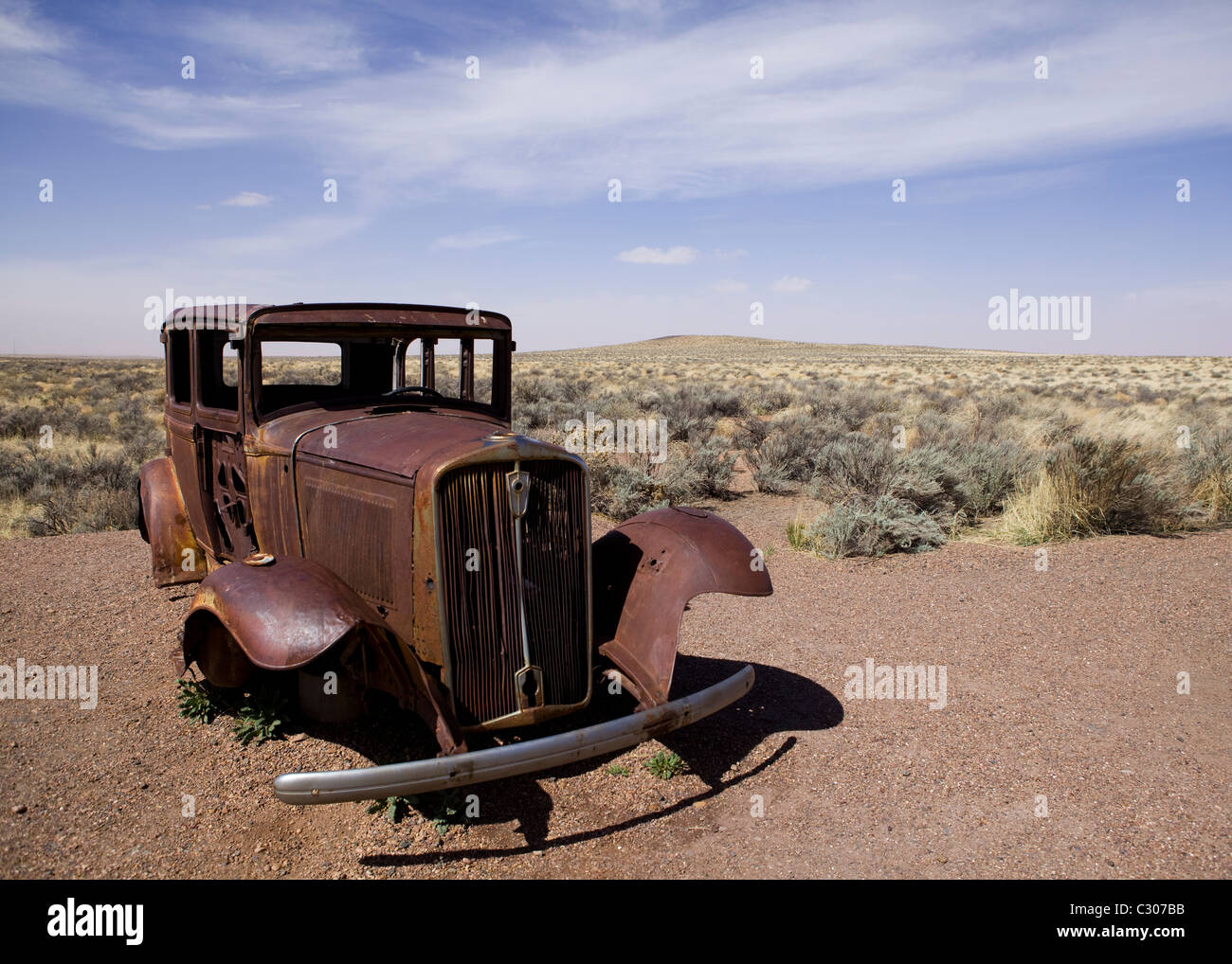 Deserted antique car in the North American desert landscape - Arizona USA - Stock Image