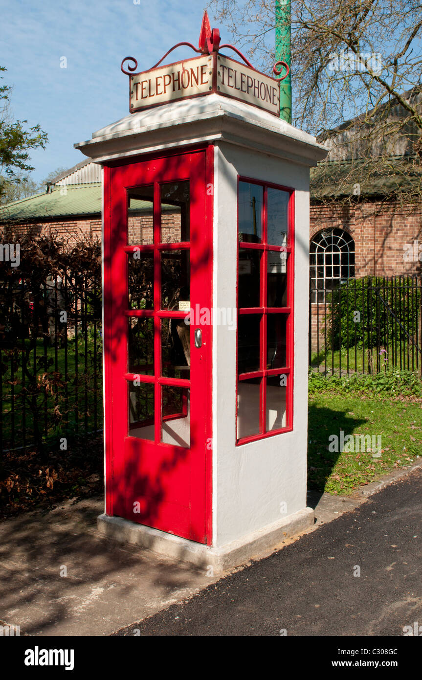 Red & White vintage phone box at Transport museum UK tourist attraction - Stock Image