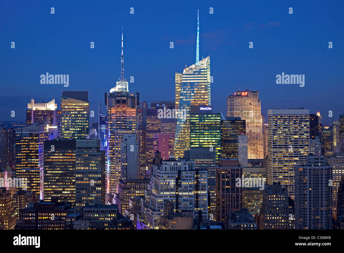 Midtown Manhattan, New York City skyline at dusk  with 4 Times Square, One Bryant Park, and the GE Building. - Stock Image