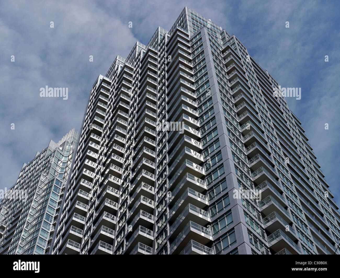 Modern high rise condominium apartment building - Stock Image