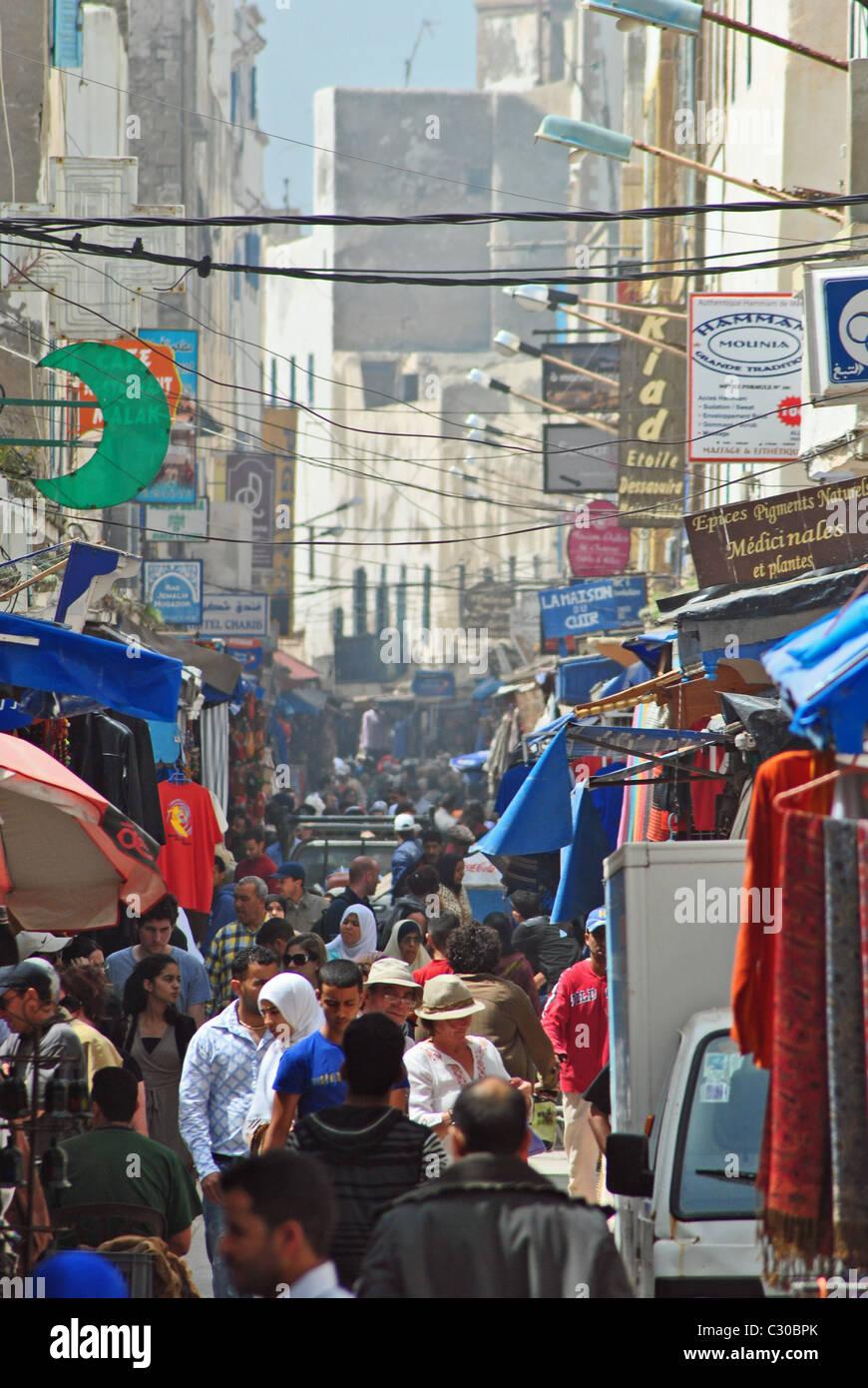 Busy street in the medina of Essouira, Morocco - Stock Image