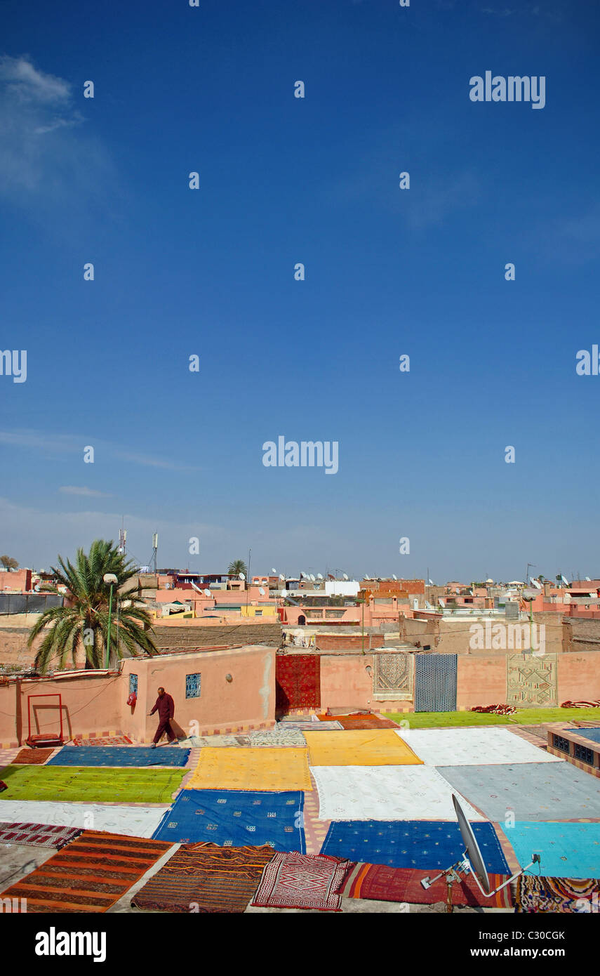 Rugs drying on a rooftop in Marrakesh, Morocco - Stock Image