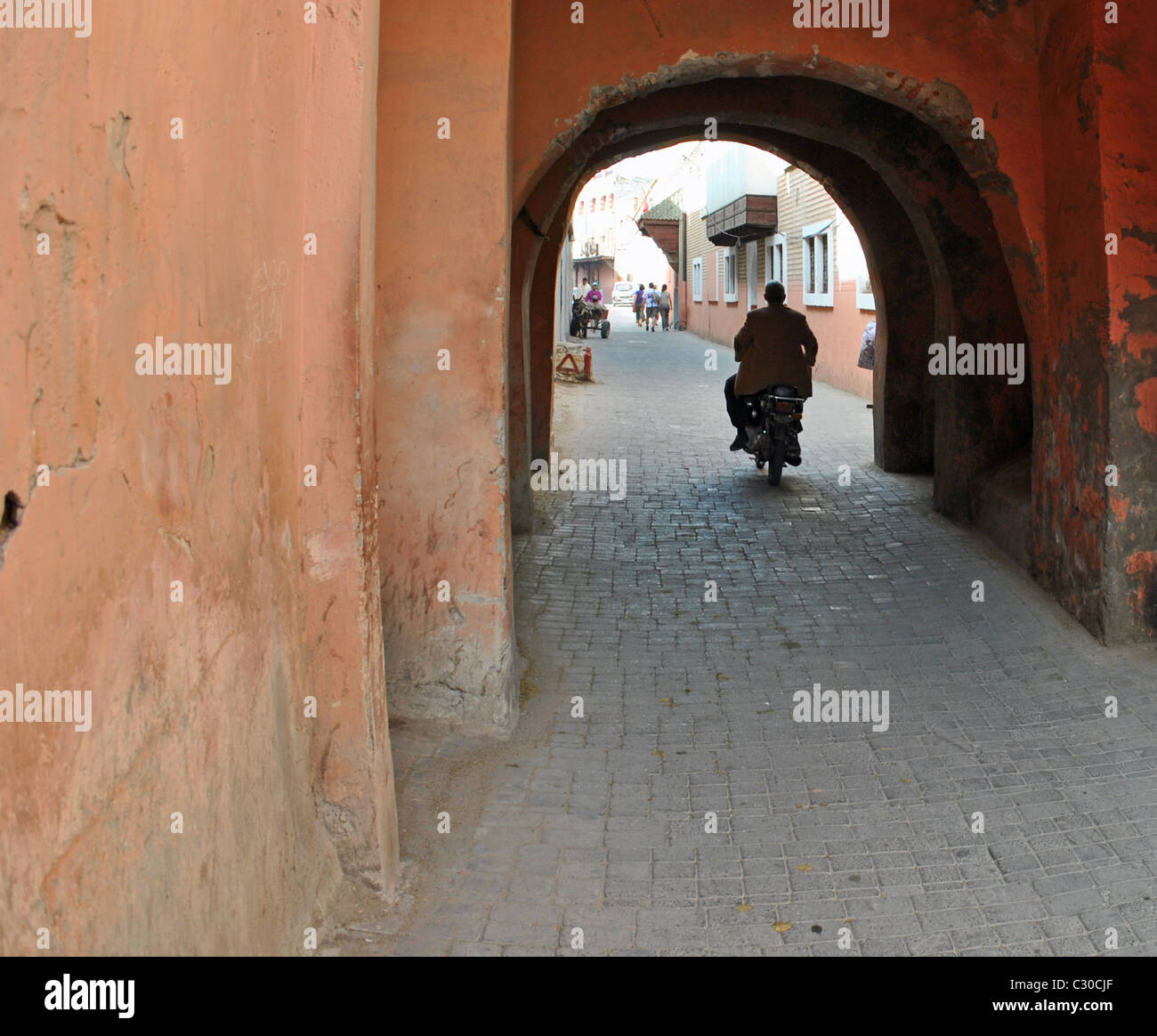 Man driving motorbike in Marrakesh, Morocco - Stock Image
