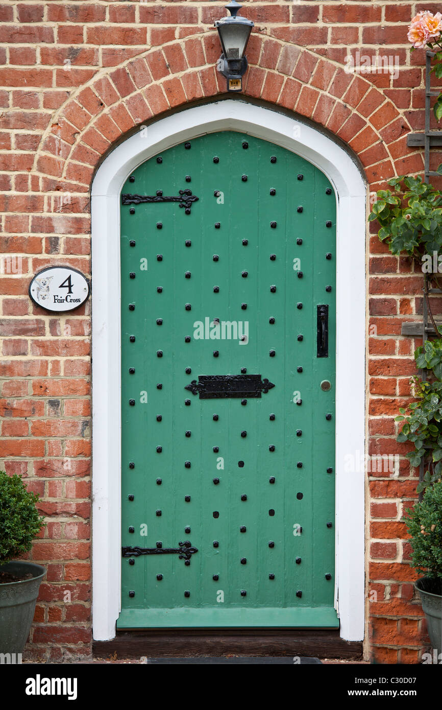 Studded arched door by Stratfield Saye House, Hampshire, United Kingdom Stock Photo