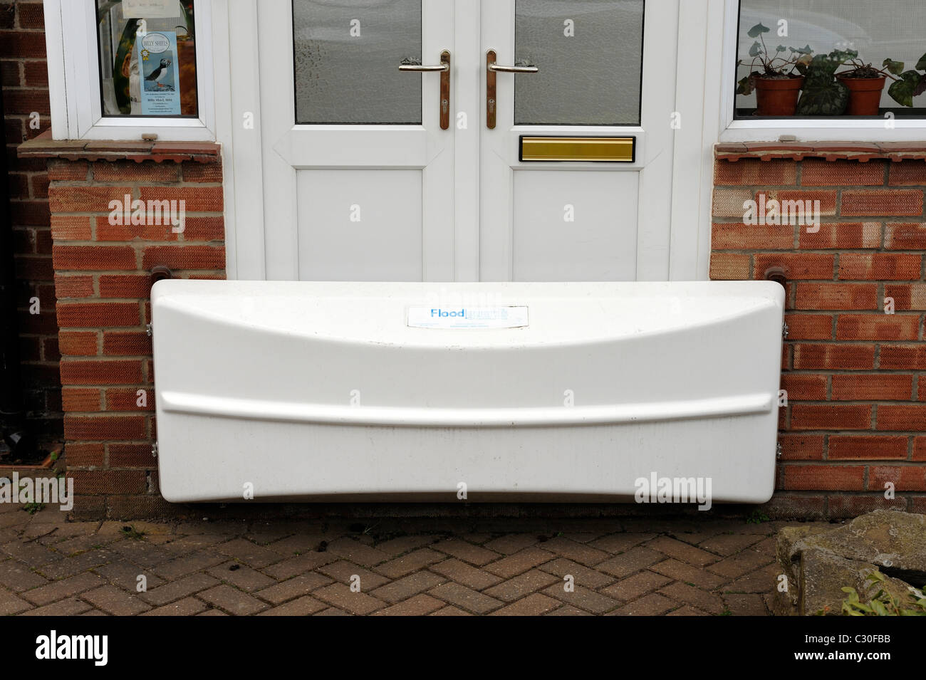 Flood defence barrier on a house - Stock Image