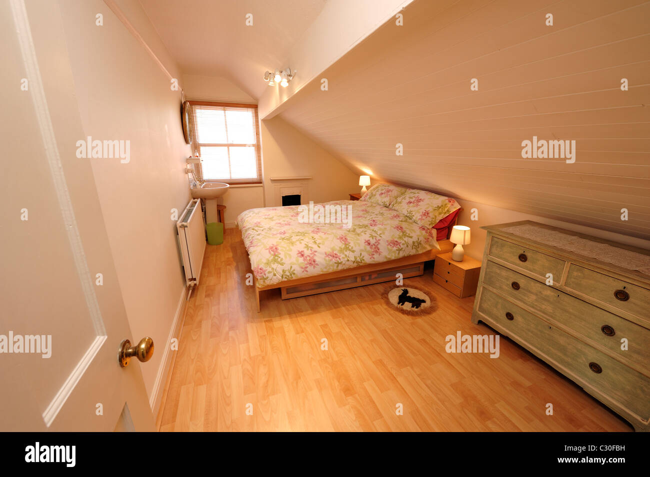 Modern loft conversion bedroom - Stock Image