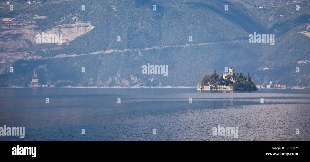 Panoramic landscape of Loreta Island on Iseo Lake, Italy. - Stock Image