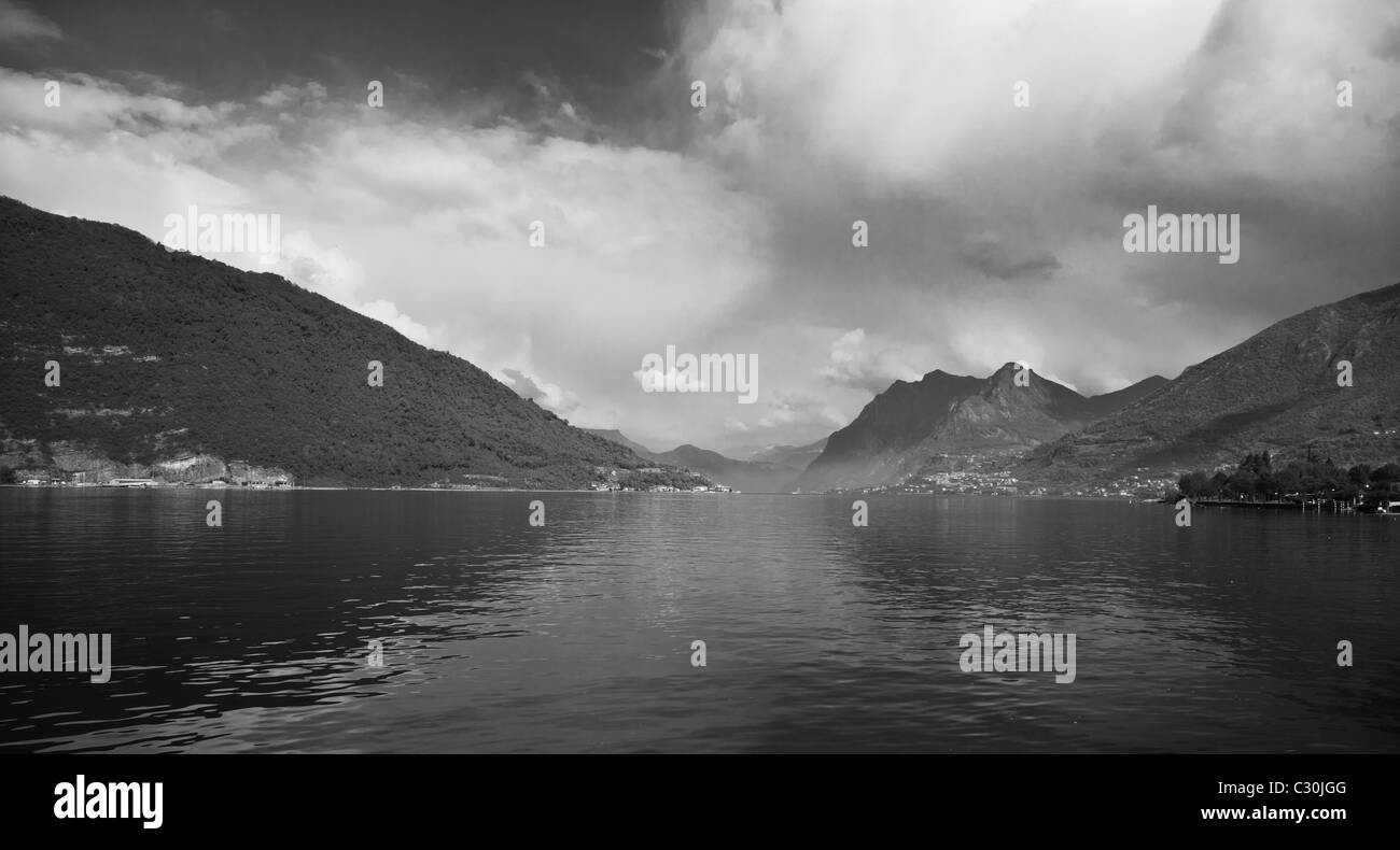 Black and white landscape in spring at Iseo Lake, Italy seen from Marone. - Stock Image