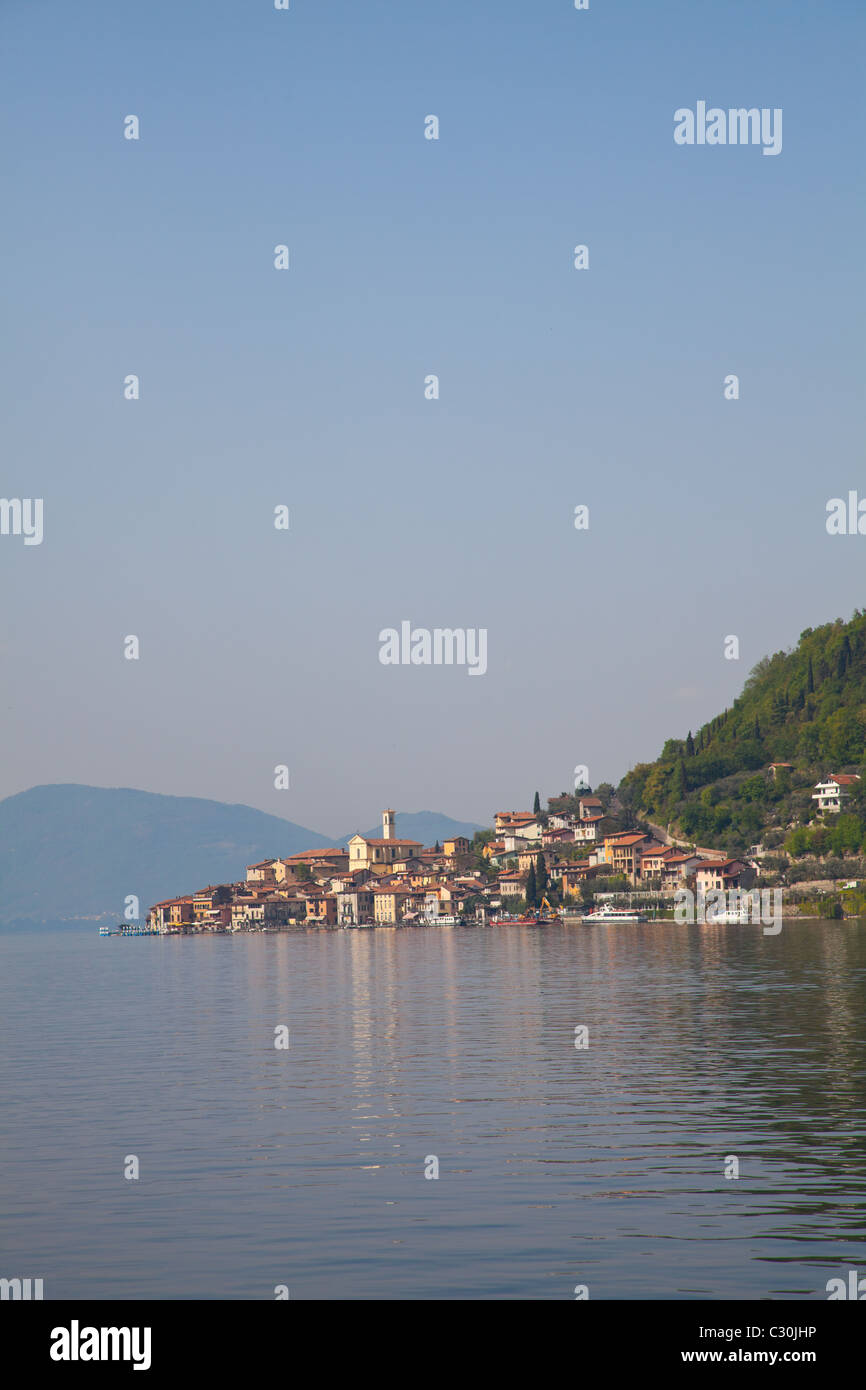 View from Sale Marasino of Peschiera Maraglio village and Iseo Lake in Italy. - Stock Image