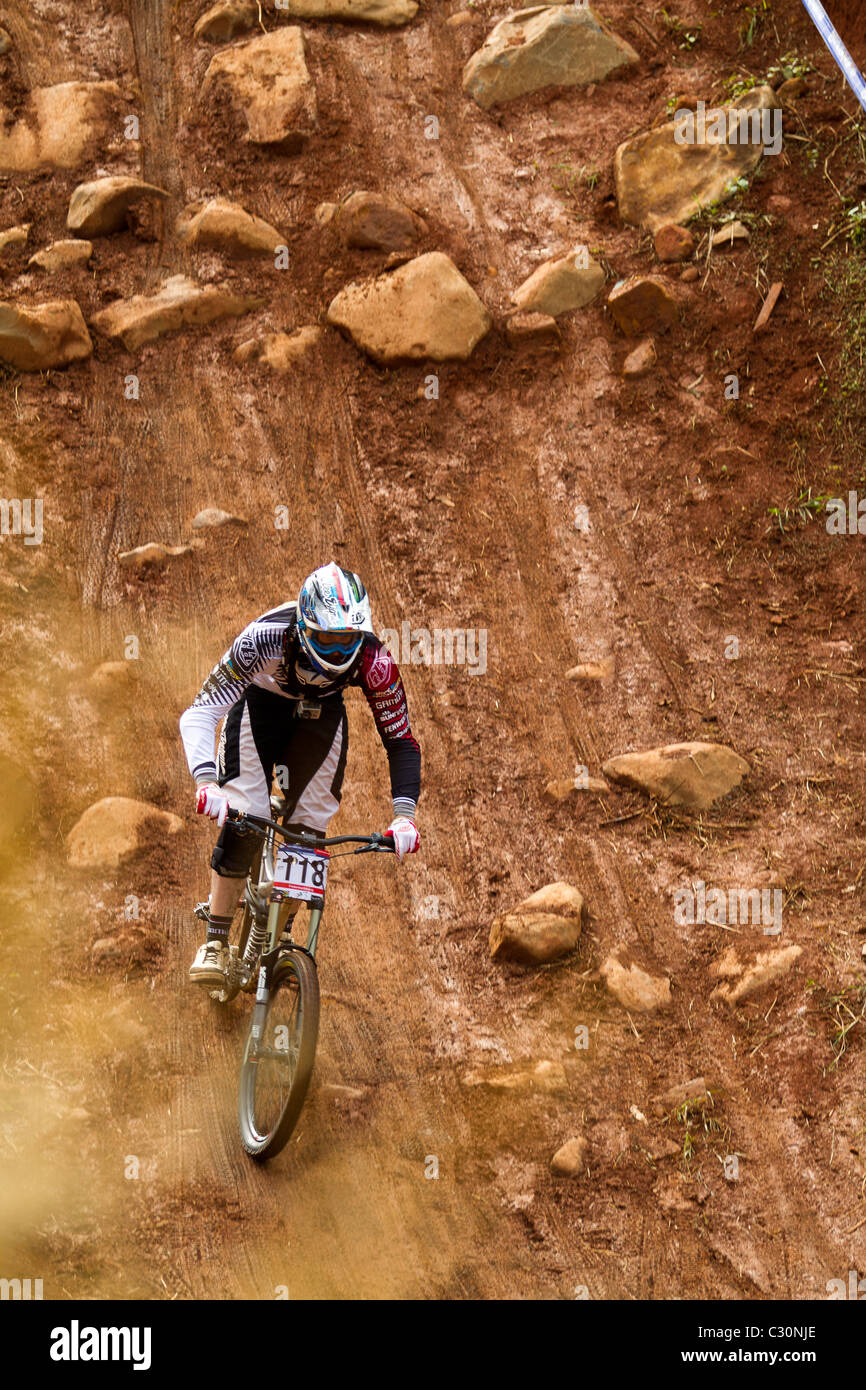 UCI MTB World Cup downhill rider practice run through rock garden - Stock Image