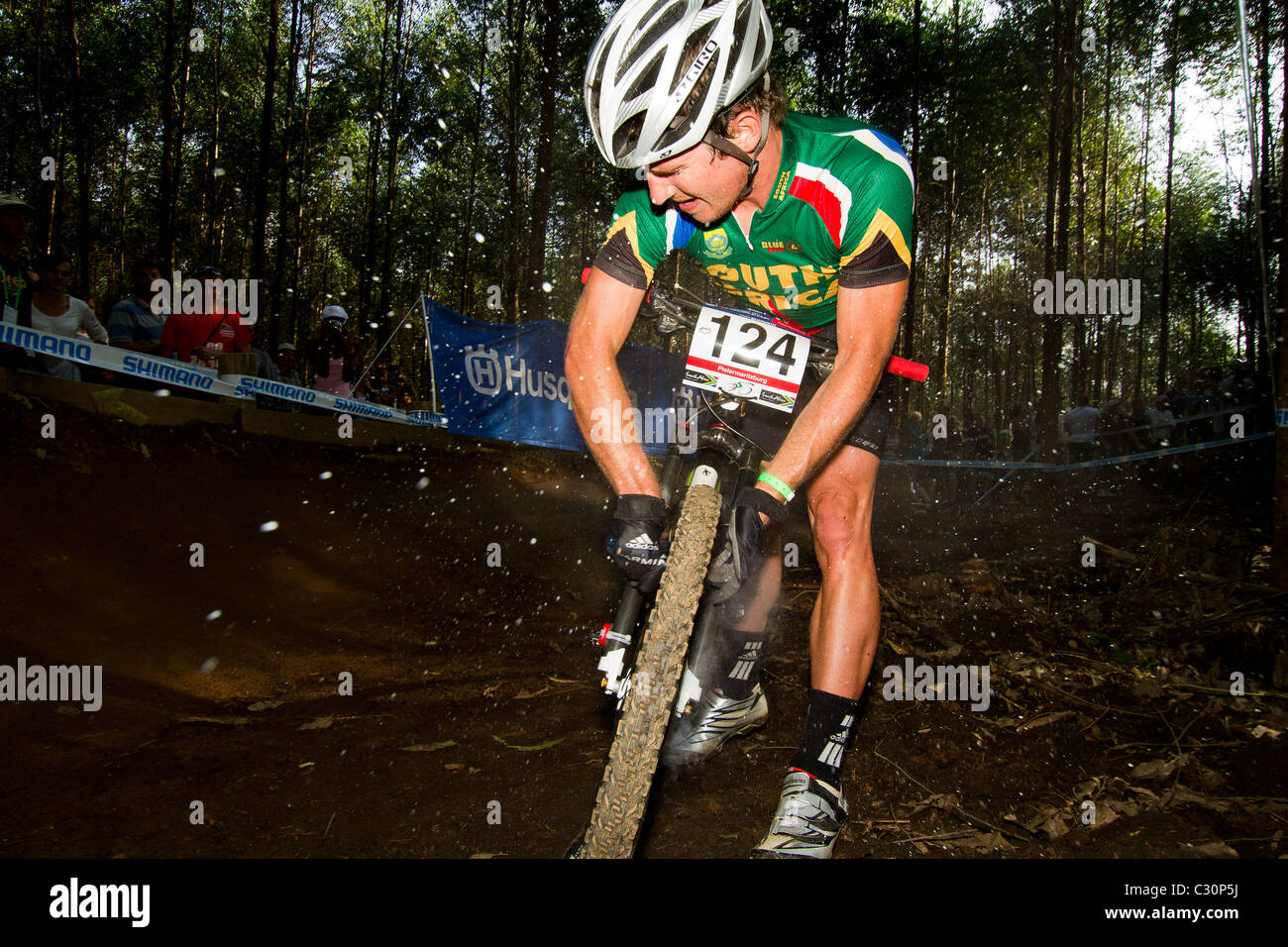 UCI MTB World Cup 2011 Round 1 Rider inflating tyre - Stock Image