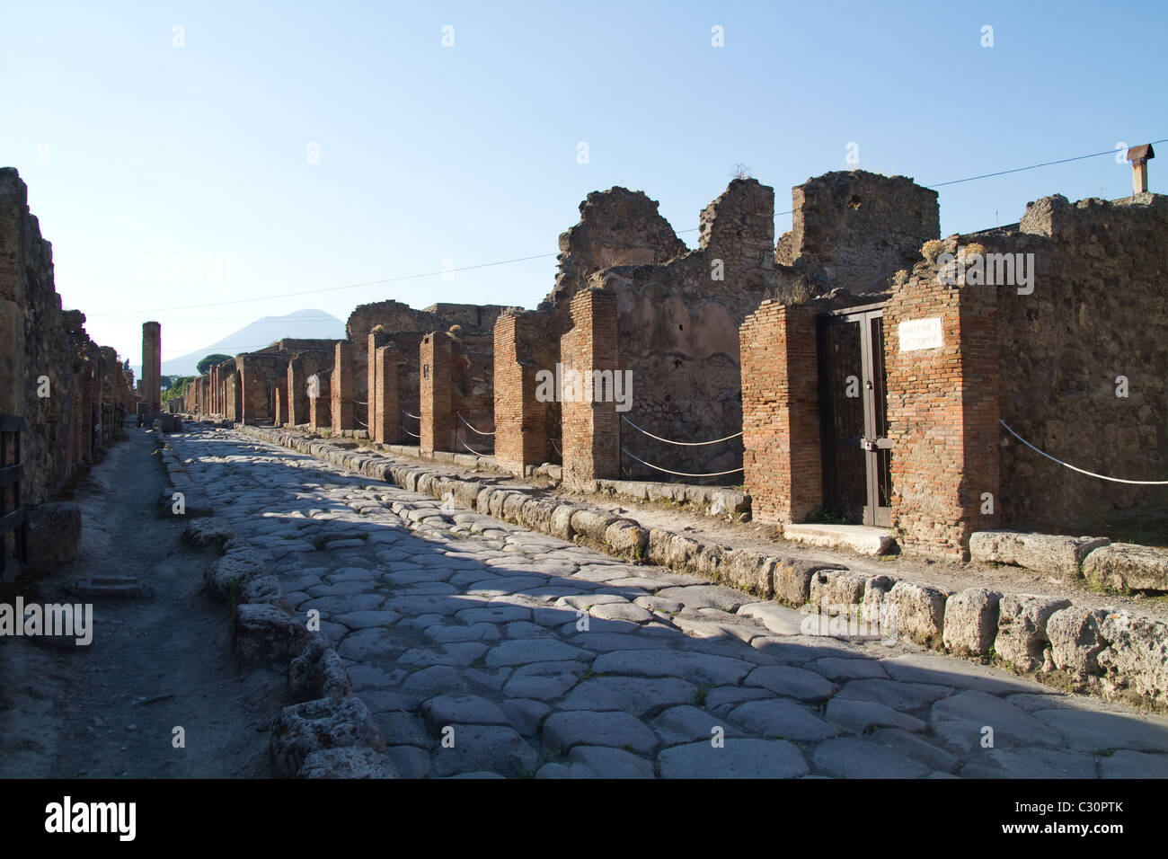 A street in ruined city of Pompeii, Italy Stock Photo