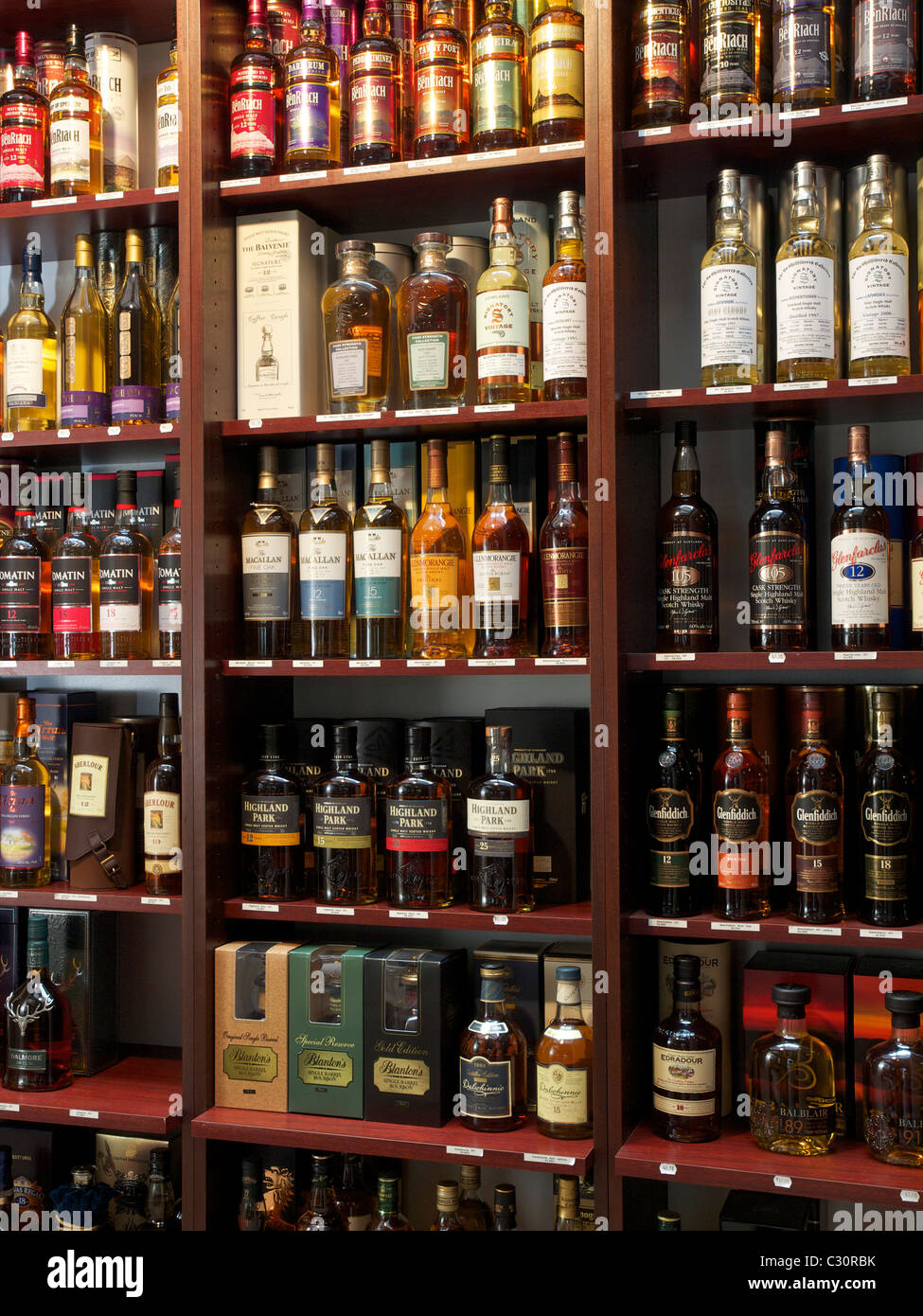 Many different kinds of Whisky bottles in a shop in Hasselt, Belgium Whiskey - Stock Image